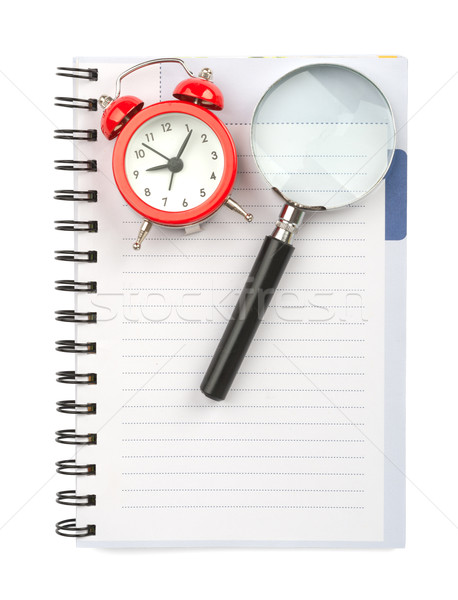 Copybook with magnifier and alarm clock Stock photo © cherezoff