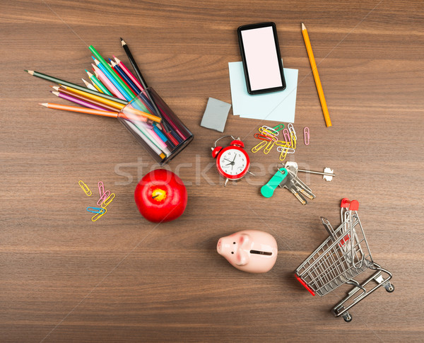 Shopping cart with office supplies and alarm clock Stock photo © cherezoff