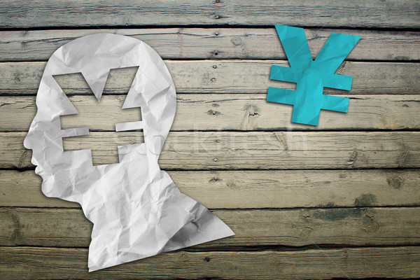 Paper humans head with yen symbol Stock photo © cherezoff