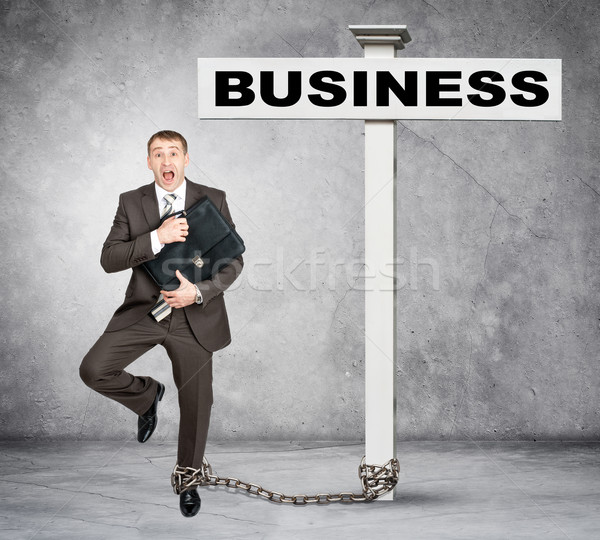 Businessman word business on post sign Stock photo © cherezoff