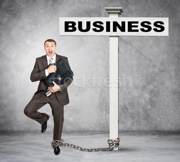 Empresário palavra negócio postar assinar assustado Foto stock © cherezoff