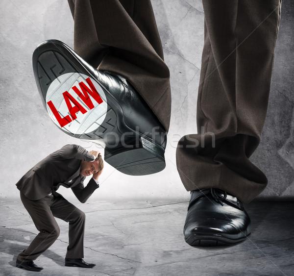 Big foot steps on businessman Stock photo © cherezoff