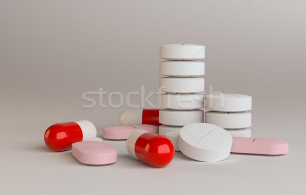 Heap of Pills, on gradient background Stock photo © cherezoff