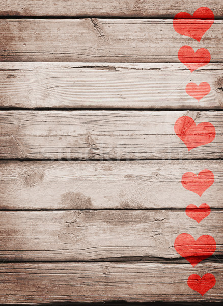 Red hearts painted on a wooden surface Stock photo © cherezoff