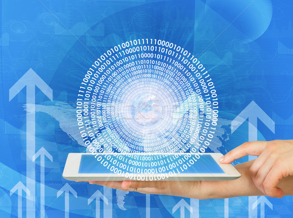 Woman hands hold tablet pc with Earth and figures Stock photo © cherezoff