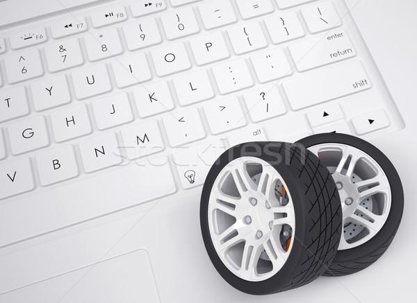 Car wheels on the keyboard Stock photo © cherezoff