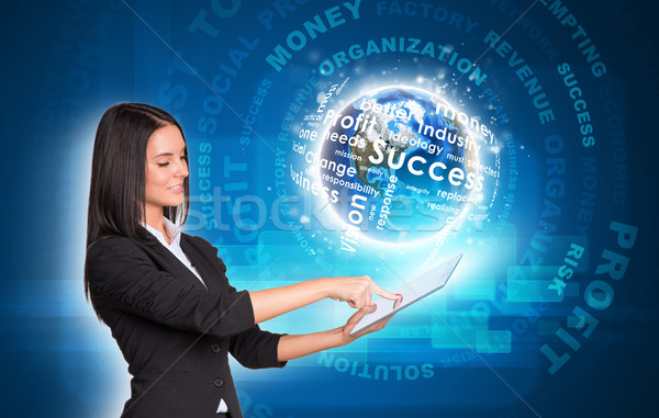 Women using digital tablet. Earth with business words Stock photo © cherezoff