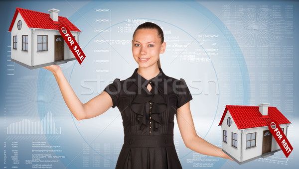 Businesswoman holding two house with tags for sale and rent Stock photo © cherezoff