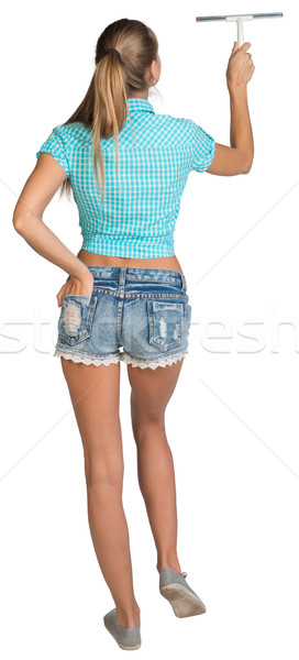 Woman using squeegee. Full length. Rear view Stock photo © cherezoff