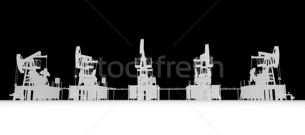 Gray silhuettes of oil pump-jacks. Front view Stock photo © cherezoff