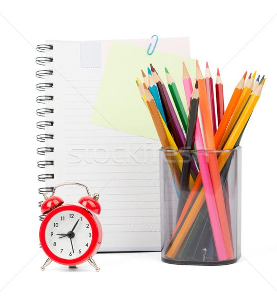 Kredki budzik notebooki odizolowany biały front Zdjęcia stock © cherezoff