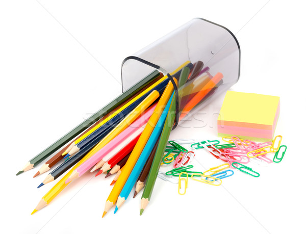 Fallen pencil cup with crayons and stickers Stock photo © cherezoff
