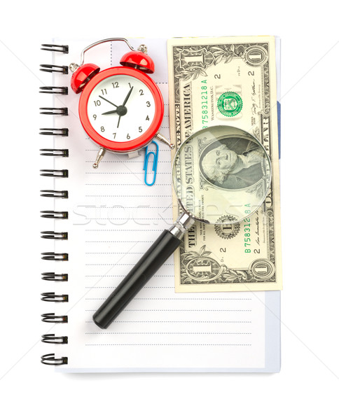 Copybook with loupe and cash Stock photo © cherezoff