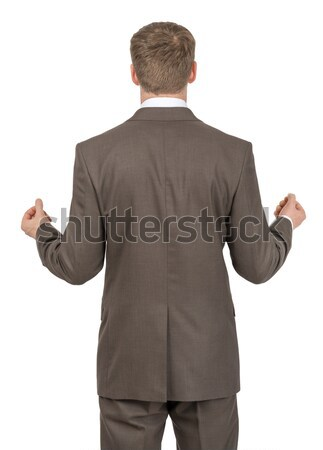 Businessman holding empty space, rear view Stock photo © cherezoff