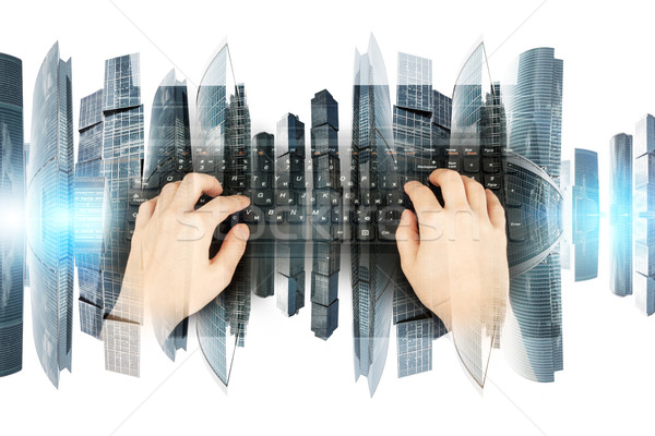 Womans hands with black keyboard Stock photo © cherezoff