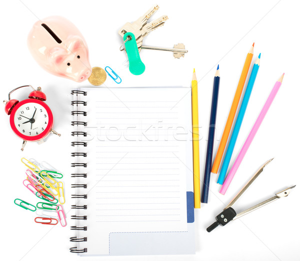 Stock photo: Open notebook with stationery and keys