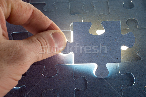 Missing jigsaw puzzle piece with light glow Stock photo © cherezoff