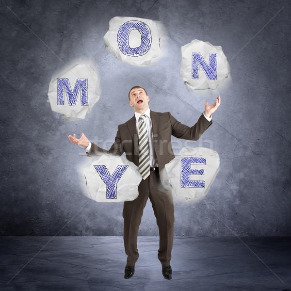 Empresário malabarismo palavra dinheiro abstrato cinza Foto stock © cherezoff