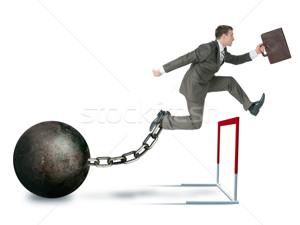 Businessman hoppig over barrier Stock photo © cherezoff