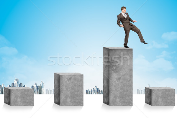 Businessman stepping up some cubes Stock photo © cherezoff
