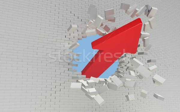 Red Arrow breaks a brick wall Stock photo © cherezoff