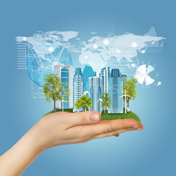 Hand grasveld stad wolkenkrabbers grafieken Stockfoto © cherezoff