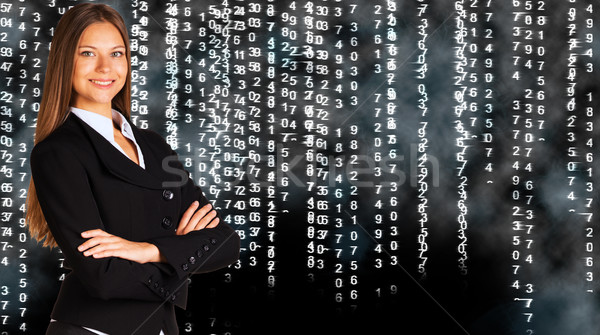 Businesswoman in a suit. White glowing figures Stock photo © cherezoff