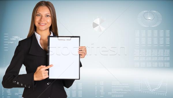 Femme d'affaires papier graphiques main construction Photo stock © cherezoff