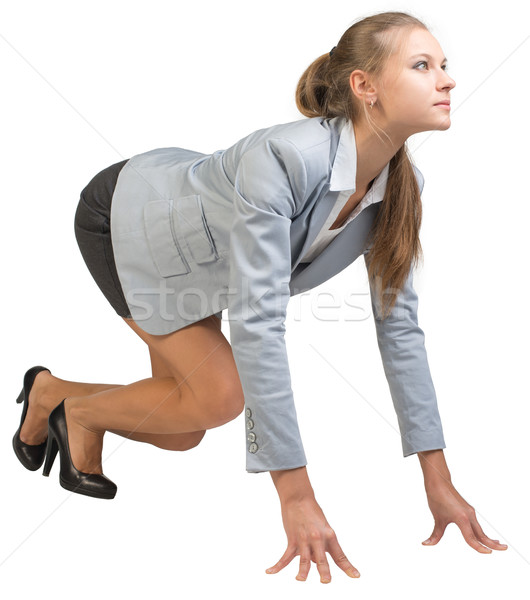 Businesswoman standing in running start pose Stock photo © cherezoff