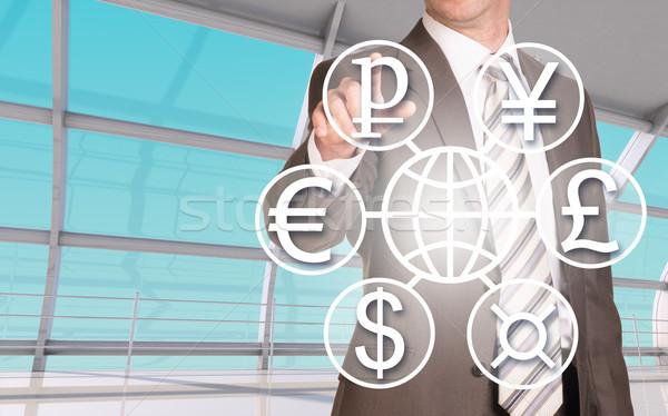 üzletember kisajtolás holografikus képernyő különböző pénznemek Stock fotó © cherezoff