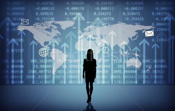 Businesswomans silhouette with symbols Stock photo © cherezoff