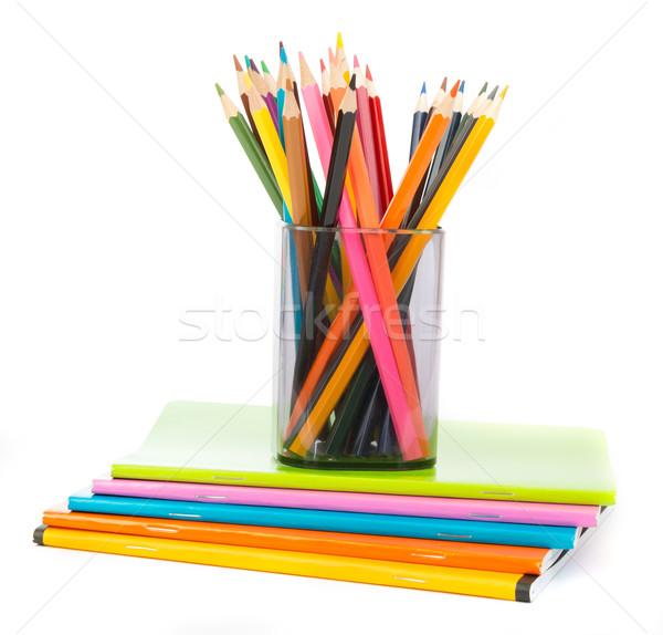 Ceruza csésze zsírkréták testmozgás könyvek izolált Stock fotó © cherezoff