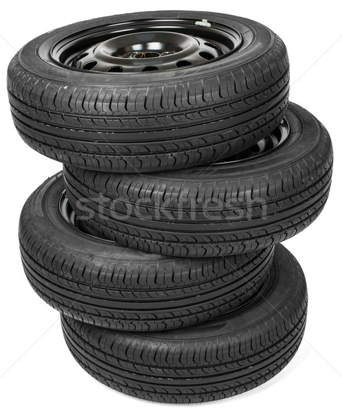 Stack of four wheel black tyres for summer Stock photo © cherezoff