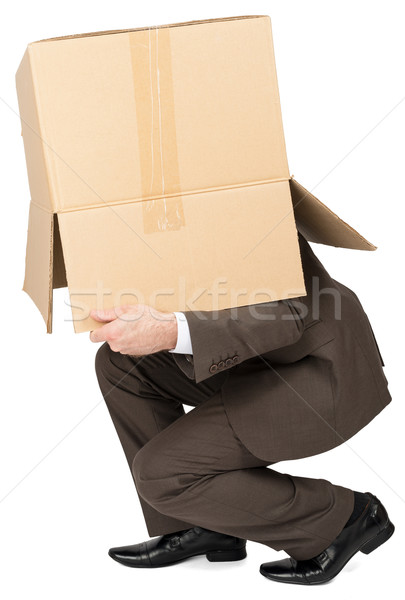 Businessman running with brown box on his head Stock photo © cherezoff