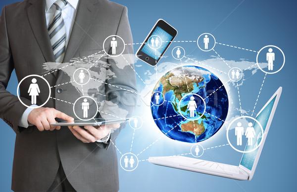 Stockfoto: Man · tablet · aarde · elektronica · zakenman