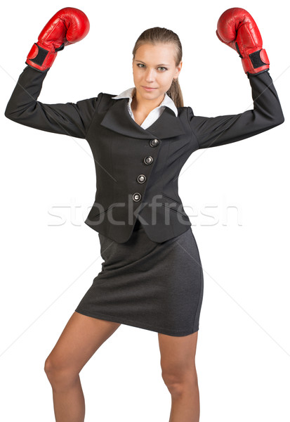 Businesswoman wearing boxing gloves standing in victory pose Stock photo © cherezoff