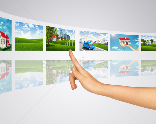 Subject homes for sale. Finger presses one of virtual screens Stock photo © cherezoff