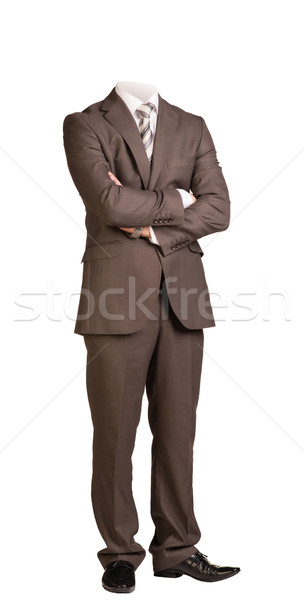 Businessman without head, standing with crossed arms. Isolated Stock photo © cherezoff