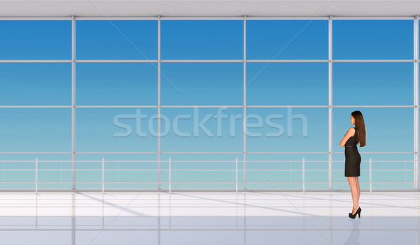 Businesswoman half-turned with crossed arms Stock photo © cherezoff
