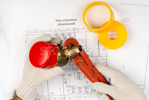 Mans hands in gloves holding water meter Stock photo © cherezoff