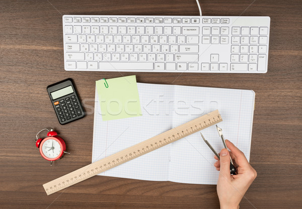 Humans hands with ruler and divider Stock photo © cherezoff
