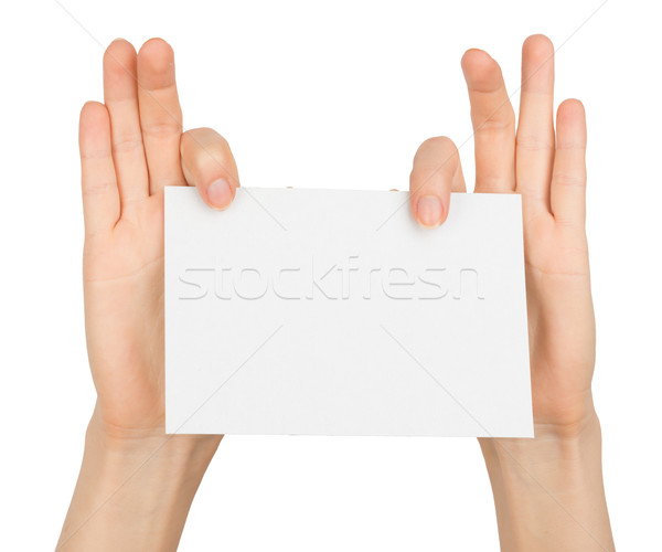 Womans right hand holding blank card with fingers Stock photo © cherezoff