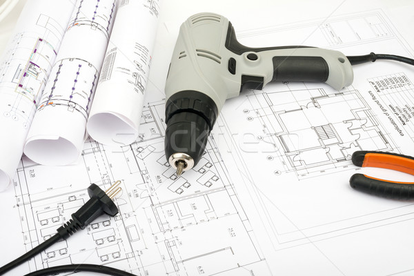 Architecture plan and rolls of blueprints Stock photo © cherezoff