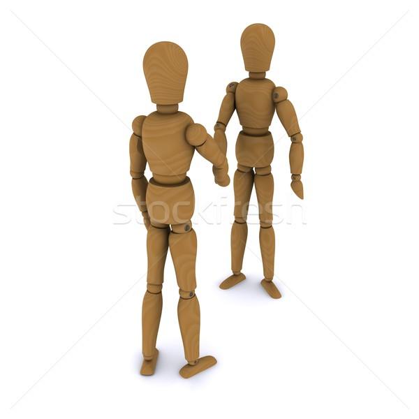 Handshake of two wooden dolls. 3D rendering Stock photo © cherezoff