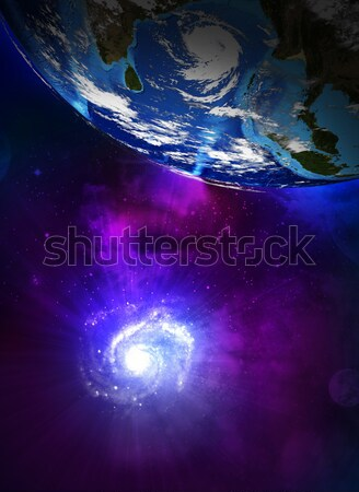 Earth planet and the spiral galaxy Stock photo © cherezoff