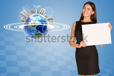 Beautiful girl holding house from the air. Many hands are given keys Stock photo © cherezoff
