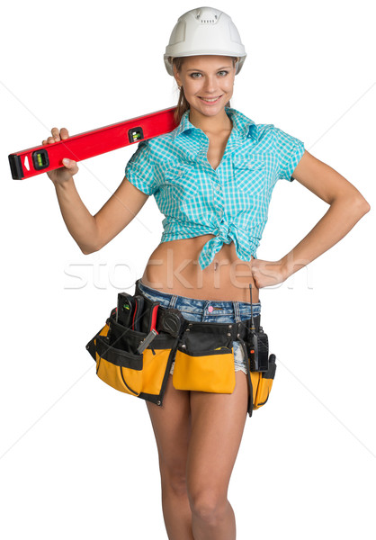 Beautiful girl in white helmet, shorts and shirt holding builder's level on the shoulder Stock photo © cherezoff