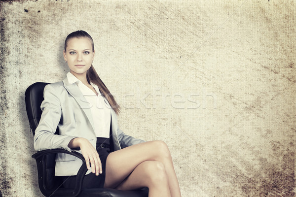 Businesswoman in office chair, looking at camera Stock photo © cherezoff