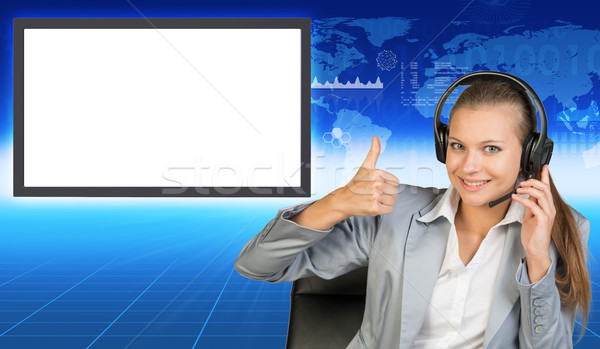 Smiling businesslady in chair and earphones Stock photo © cherezoff