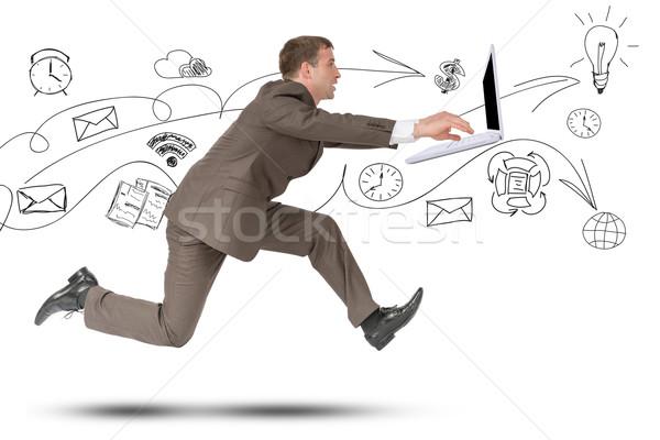 Man running fast with laptop on white Stock photo © cherezoff